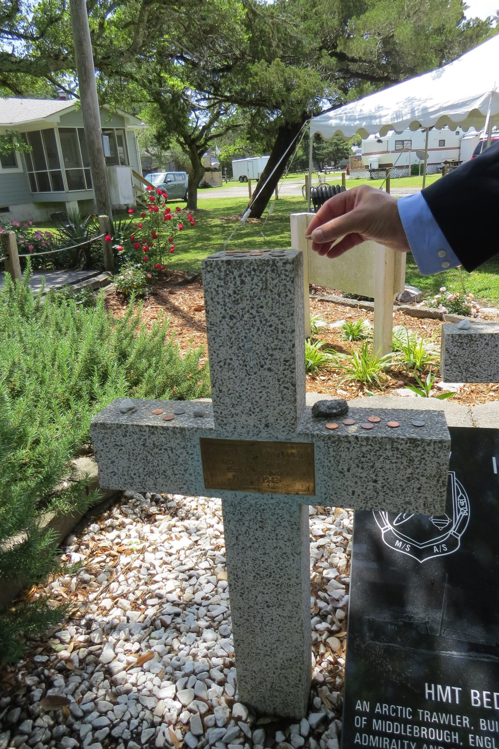 Coins and rocks left on the crosses at the British Cemetery are an old European tradition that says,