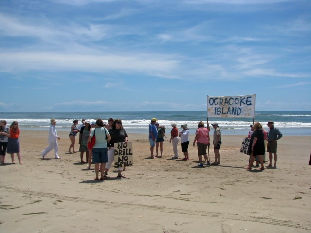 Islanders and visitors gather at the beach before joining hands. Photo by P. Vankevich