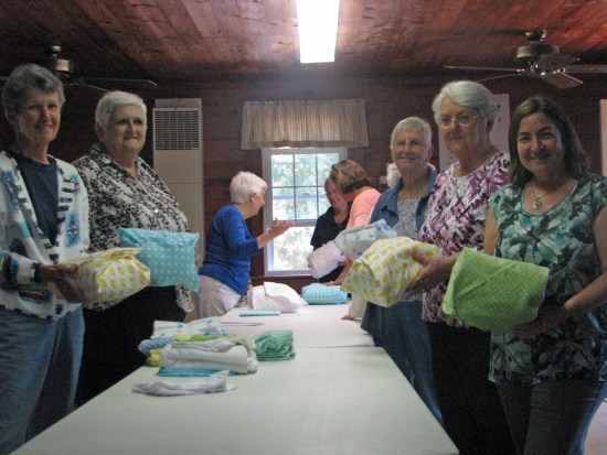 Helping assemble layette kits are, from left, Jen Esham, Stella O'Neal, Kay Riddick,Teresa Adams, Robin Turner, Annie Lou Gaskins, Martha O'Neal and Kathy Phillips. Photo by P. Vankevich