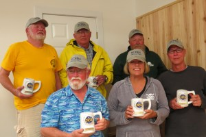 "The North Carolina Beach Buggy Association is the second place overall winners. Bill Smith, front right, caught the largest fish Friday, a 30 1/4"" drum."
