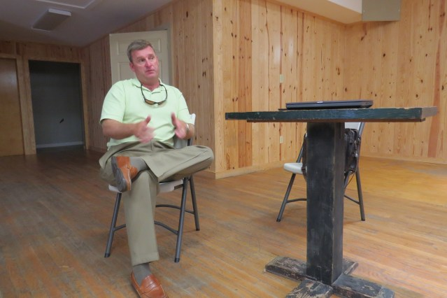 Jed Dixon, deputy Ferry Division director, talks about the Hatteras ferry Tuesday in a meeting in the Ocracoke Community Center.  Photo by C. Leinbach