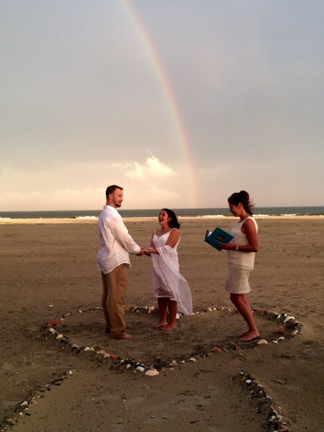 Brian Horner and Molly Brumfield get married under a double rainbow July 11. Officiant is Bonnie Williams of Hatteras Village. Photo by Betty Dixon