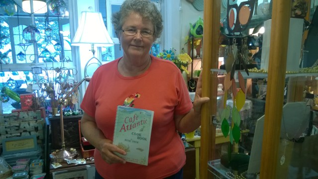 Ruth Toth with the new edition of the Café Atlantic Cookbook. Photo by P. Vankevich