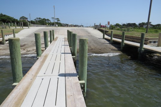 Rebuilt in 2013 after Hurricane Sandy damage in 2012, the boat launch at the end of the NPS parking lot on Ocracoke, NC, was neither long enough nor sloped sharply enough. The National Park Service will again rebuild it starting Jan. 18. Photo by C. Leinbach