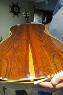 An acoustic guitar Willis crafted from rosewood.