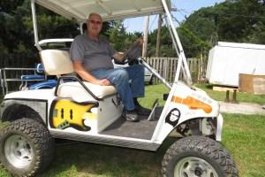 Jackie Willis in his 'art' golf cart.