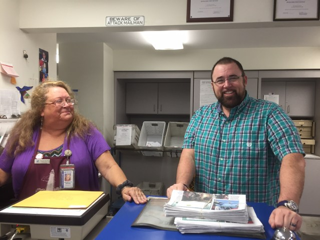 Dale Mutro, right, native islander who in August took a two-year job as postmaster in Unakaleet, Alaska, was on Ocracoke visiting this week. He promptly visited Celeste Brooks, Ocracoke postmaster.