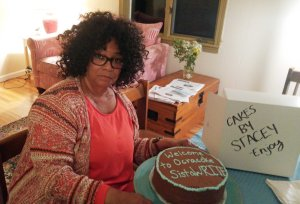 Writer Jaki Shelton Green with a cake prepared by Stacey O'Neal for SistaWrite, Green's women's writers group. Photo by P. Vankevich