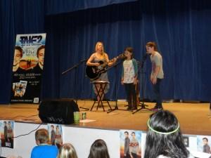 Emilia Jordon, center, and Maren Donlon, right, perform