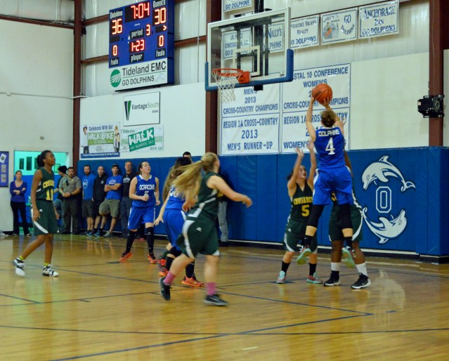 Sydney Austin takes a jump shot. Photo by Stacey O'Neal