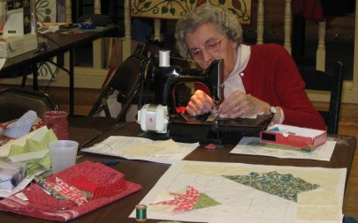 Eleanor Garrish sewing with the Ocracoke Quilters. Photo by Cindy Hitchens