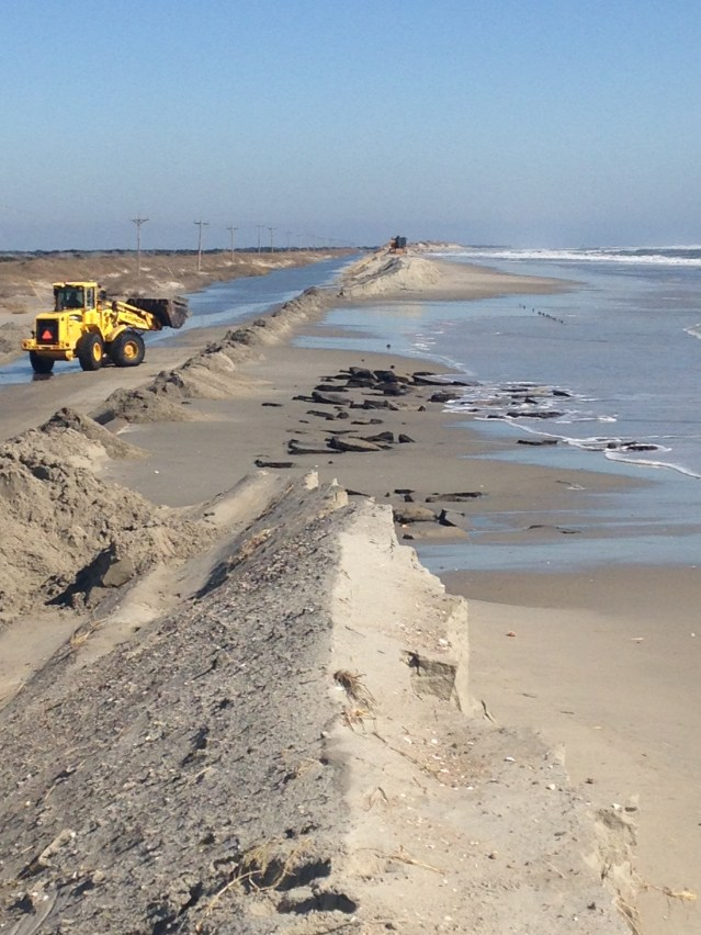 The north end of Ocracoke was closed part of Monday following the ocean breaching the road during Sunday's storm. Photo by William Boyd
