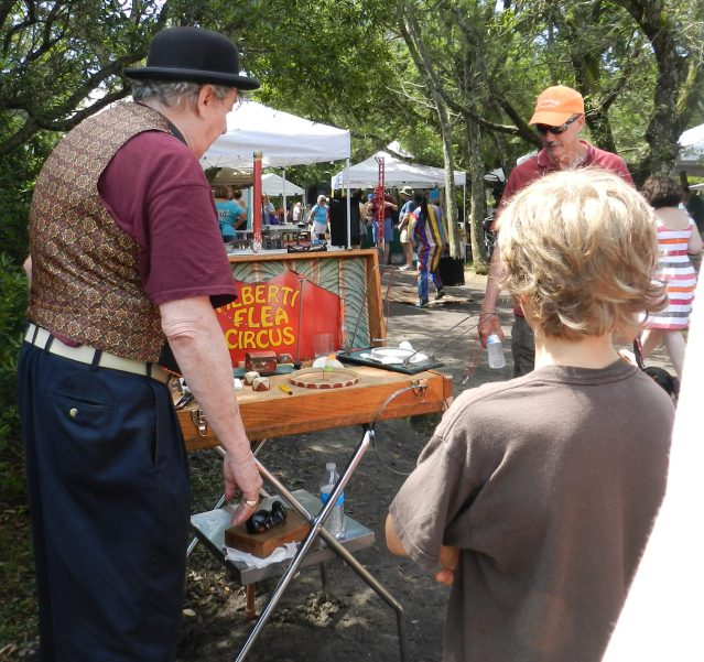 Jim Alberti wows passersby with his flea circus. Photo: C. Leinbach