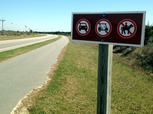 Golf carts are not allowed on Highway 12 past Howards Pub, or on the bike path.