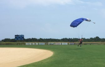 A skydiver lands Monday afternoon on the infield of the Ocracoke Community Park ball field. Photo by C. Leinbach