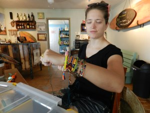 Emily Kirby visits Island Vibe where some of her handmade friendship bracelets are for sale. Photo: C. Leinbach