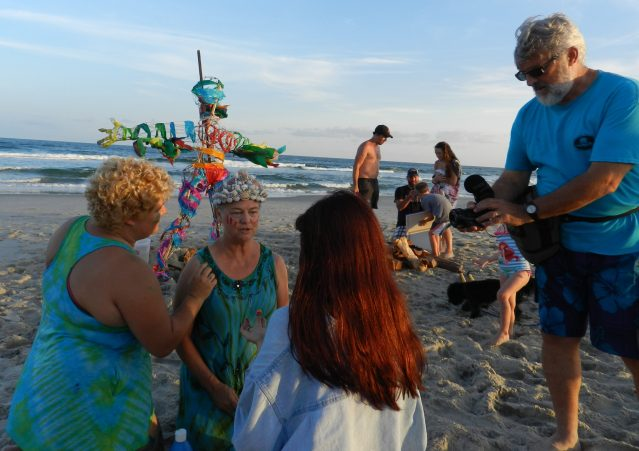 Kitty Mitchell, center, gets 'war paint' before the burn. With her, from left, are daughter Katy, neice Lauren, and husband, Gary, who filmed the event.