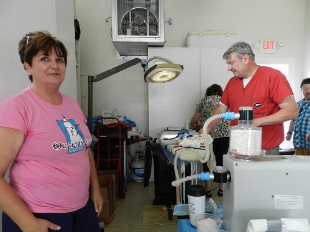 Stephanie O'Neal helps with the clinic. Dr. Howard Johnson is at right. Photo: C. Leinbach