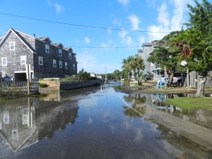 Water from high tide Tuesday afternoon continued to creep into the village. Photo: C. Leinbach