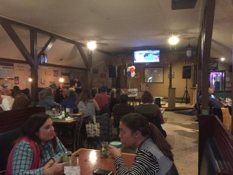 Islanders and visitors watch the general election returns Tuesday night in the Ocracoke Oyster Co.