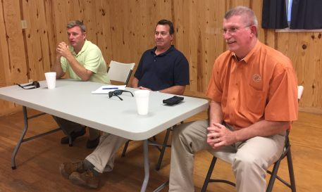 Harold Thomas, right, the new director of the N.C. Ferry Division, talks with islanders in the Ocracoke Community Center along with Chris Bock, center, superintendent of operations at Hatteras, and Jed Dixon, deputy Ferry Division director. Photo: C. Leinbach