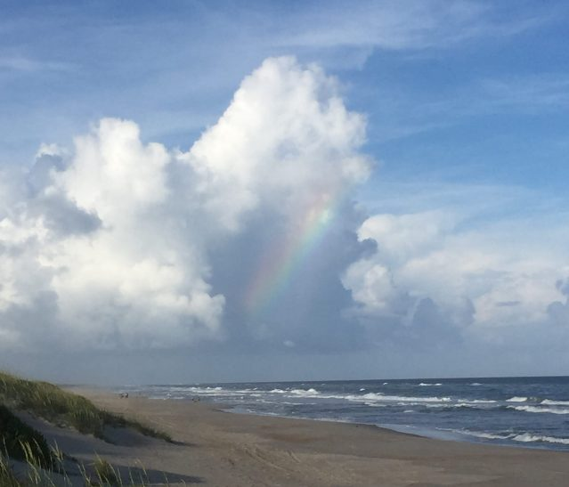 A post-storm cumulus congestus, seen from the pony pen beach,Ocracoke, with an internal rainbow. Photo: C. Leinbach