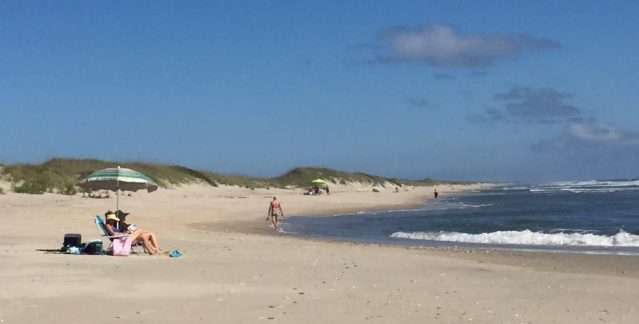 Visitors enjoy summer-like weather and warm water at the Pony Pen beach, Ocracoke, NC. Photo: Connie Leinbach