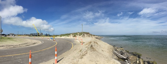 This photo shows the damaged road in the water at right. The N.C.DOT has begun work to shoring up the beach and repair the road at the north end of Ocracoke, NC. Photo: C. Leinbach