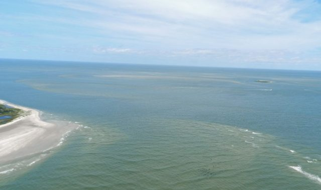 Aerial view of the Hatteras Inlet shows the increased shoaling in recent years, resulting in a longer ferry ride to Ocracoke, N.C., and the advent of a passenger ferry, expected to be ready this fall with full service next year. Photo: C. Leinbach