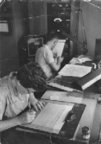 Inside the second Hatteras Weather Bureau Station, 1955. Lucy Stowe, left, plots radiosonde data while Carl Hollis staffs the radiosonde recording device. Life Magazine photo