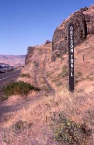 Oregon Trail marker placed next to trail ruts