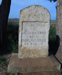 engraved stone marker with words Junction of Oregon Trail with Overland Trail