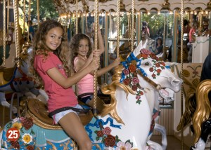 Two girls on a carousel horse