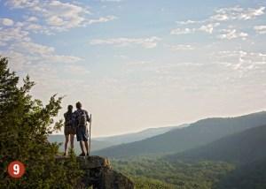 Couple on mountain ledge
