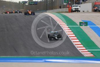 World © Octane Photographic Ltd. Formula 1 – F1 Portuguese GP, Race. Mercedes AMG Petronas F1 W11 EQ Performance - Valtteri Bottas and McLaren MCL35 – Carlos Sainz. Autodromo do Algarve, Portimao, Portugal. Sunday 25th October 2020.