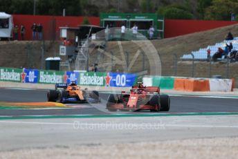 World © Octane Photographic Ltd. Formula 1 – F1 Portuguese GP, Race. Scuderia Ferrari SF1000 – Charles Leclerc and McLaren MCL35 – Carlos Sainz. Autodromo do Algarve, Portimao, Portugal. Sunday 25th October 2020.