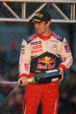 © North One Sport Limited 2010/ Octane Photographic Ltd. 2010 WRC Great Britain Podium, Sunday 14th November 2010, Loeb sprays the victory champagne. Digital ref : 0114CB1D1374