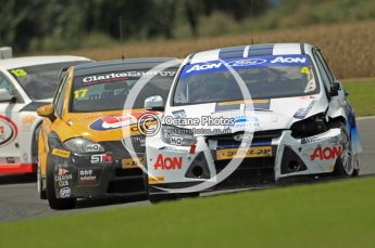 © Octane Photographic Ltd. 2011. British Touring Car Championship – Snetterton 300, a battle scarred Tom Onslow-Cole - Ford Focus - Team Aon holds off Dave Newsham in his Special Tuning Racing SEAT Leon. Sunday 7th August 2011. Digital Ref : 0124CB1D4235