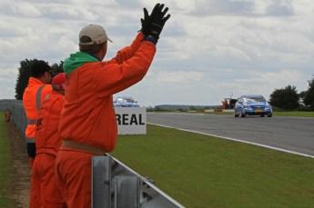 © Octane Photographic Ltd. 2011. British Touring Car Championship – Snetterton 300, Sunday 7th August 2011. Marshalls cheer the finishing cars. Digital Ref : 0124LW7D0978