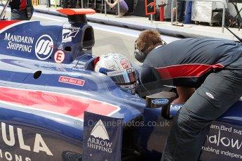 © Octane Photographic Ltd. 2011. European Formula1 GP, Friday 24th June 2011. GP2 Practice. Sam Bird - iSport International getting his belts tightened. Digital Ref: 0082CB1D6246