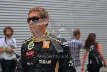 © Octane Photographic Ltd. 2011. European Formula1 GP, Friday 24th June 2011. Formula 1 paddock. Vitaly Petrov - Lotus Renault GP Digital Ref: 0086LW7D5975