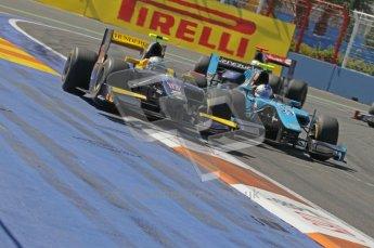 © Octane Photographic Ltd. 2011. European Formula1 GP, Sunday 26th June 2011. GP2 Sunday race. Adam Carroll - Super Nova battling with Johnny Cecotto - Ocean Racing Technology. Digital Ref: 0090CB1D9325