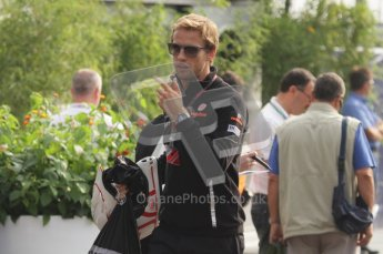 © Octane Photographic Ltd. 2011. Formula 1 World Championship – Italy – Monza – 11th September 2011. Race Day in the Paddock. Jenson Button walking into the paddock before the race. Digital Ref : 0193LW7D6600