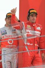 © Octane Photographic Ltd. 2011. Formula 1 World Championship – Italy – Monza – 11th September 2011 – Podium –Jenson Button (McLaren) and Fernando Alonso (Ferrari) walking into the podium. Digital Ref : 0178CB1D4129