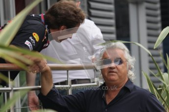 © Octane Photographic Ltd. 2011. Formula 1 World Championship – Italy – Monza – 10th September 2011, Flavio Briatore shakes hands with Christian Horner of Red Bull Racing – Free practice 3 – Digital Ref :  0175LW7D5887