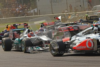 © Octane Photographic Ltd. 2011. Formula 1 World Championship – Italy – Monza – 11th September 2011 – Wings and carbon fibre fly as Nico Rosberg (Mecedes) and Vitaly Petrov (Renault) are hit by Viantonio Liutzi (HRT) – Race – Digital Ref :  0177CB7D7851