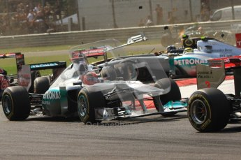 © Octane Photographic Ltd. 2011. Formula 1 World Championship – Italy – Monza – 11th September 2011 Wings and carbon fibre fly as Nico Rosberg (Mecedes) and Vitaly Petrov (Renault) are hit by Viantonio Liutzi (HRT) – Race – Digital Ref :  0177CB7D7852