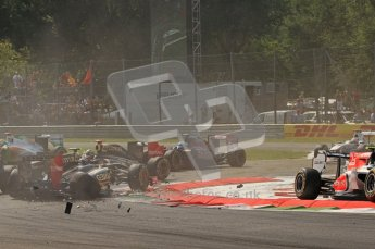 © Octane Photographic Ltd. 2011. Formula 1 World Championship – Italy – Monza – 11th September 2011 - Debris showers the track after the accident caused by Viantonio Liutzi (HRT) takes out Nico rosberg (Mercedes) and Vitaly Petrov (Renault) – Race – Digital Ref :  0177CB7D7865