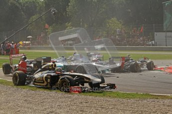 © Octane Photographic Ltd. 2011. Formula 1 World Championship – Italy – Monza – 11th September 2011 Brun Senna (Renault) escapes across the grass to avoid the 1st corner accident – Race – Digital Ref :  0177CB7D7874