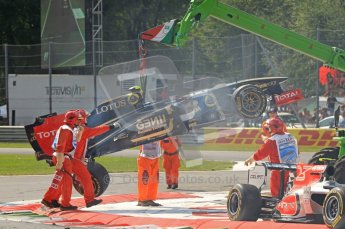 © Octane Photographic Ltd. 2011. Formula 1 World Championship – Italy – Monza – 11th September 2011 Vitaly Petrov's wrecked Renault is lifted clear of the race track after the 1st corner accident – Race – Digital Ref : 0177CB7D7916